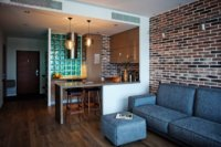 Гармоничное расположение жилых зон в квартире студии.